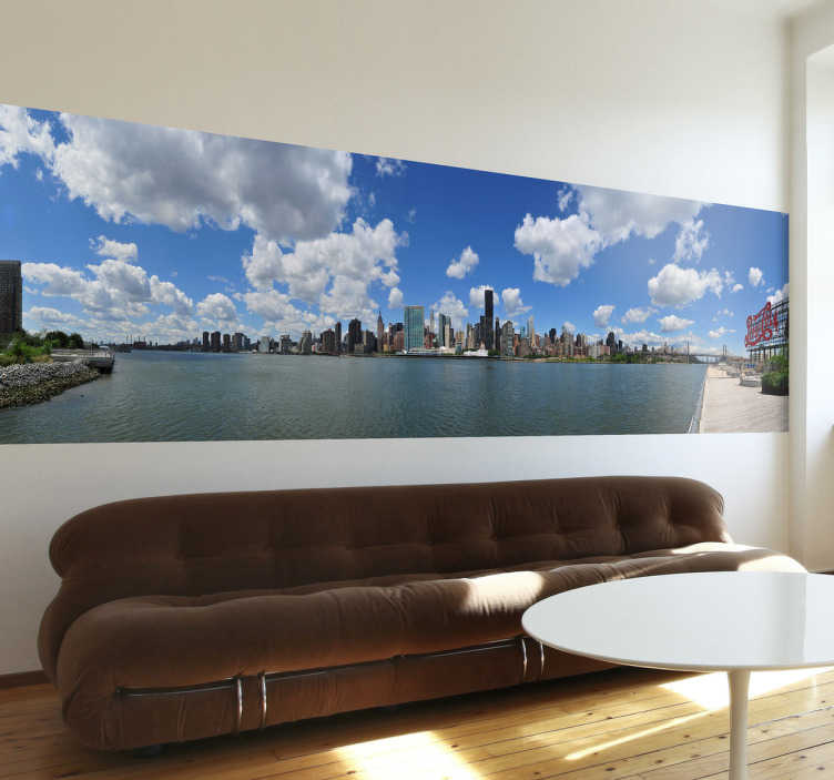 TenStickers. Naklejka dekoracyjna zatoka Manhattan. Naklejka dekoracyjna, która przedstawia zatokę obok Manhattańskiej dzielnicy miasta Nowy Jork. Piękna panorama do powieszenia w każdym pokoju.