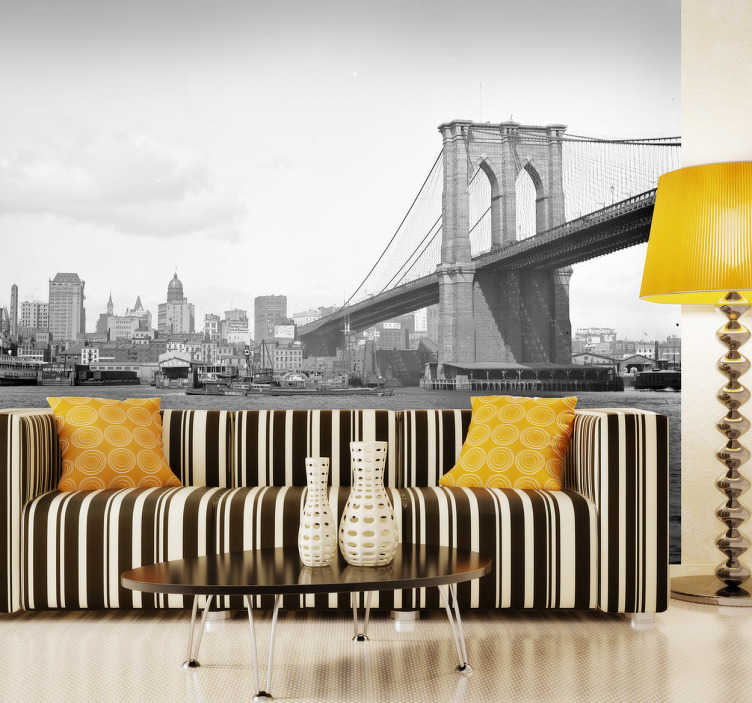 TenStickers. Sticker fotobehang Brooklyn Bridge New York. Muursticker van een foto van de Brooklyn Bridge in Manhattan, New York. Originele zwart-wit wanddecoratie voor de versiering van kale muren.