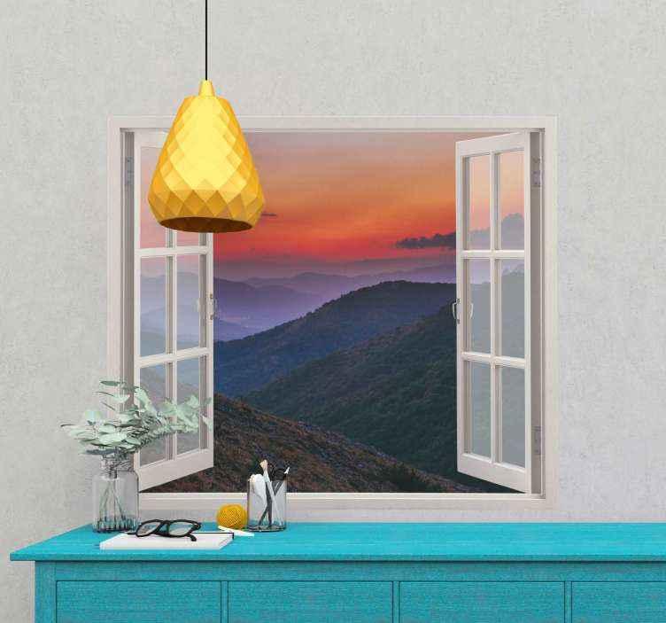 TENSTICKERS. サンセットマウンテンステッカー. 窓枠の中に夕日の山々の見事な写真が描かれた山の壁のステッカー。 10%オフにサインアップしてください。