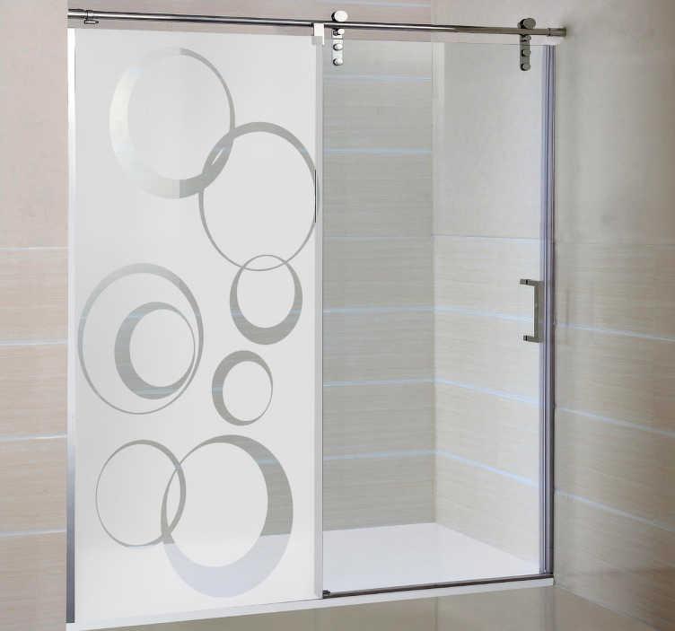 TenStickers. Sticker paroi douche cercles. Habillez votre paroi de douche et préservez votre intimité avec cet original sticker opaque. Nous adaptons le sticker aux dimensions de votre paroi.