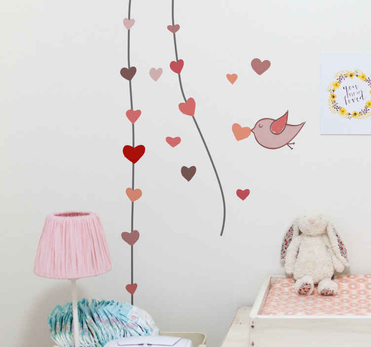 TenStickers. Kids Hearts Bird Wall Sticker. An illustration of a bird carrying a heart in its beak adding to a line of hanging hearts. A sweet design from our collection of heart stickers.