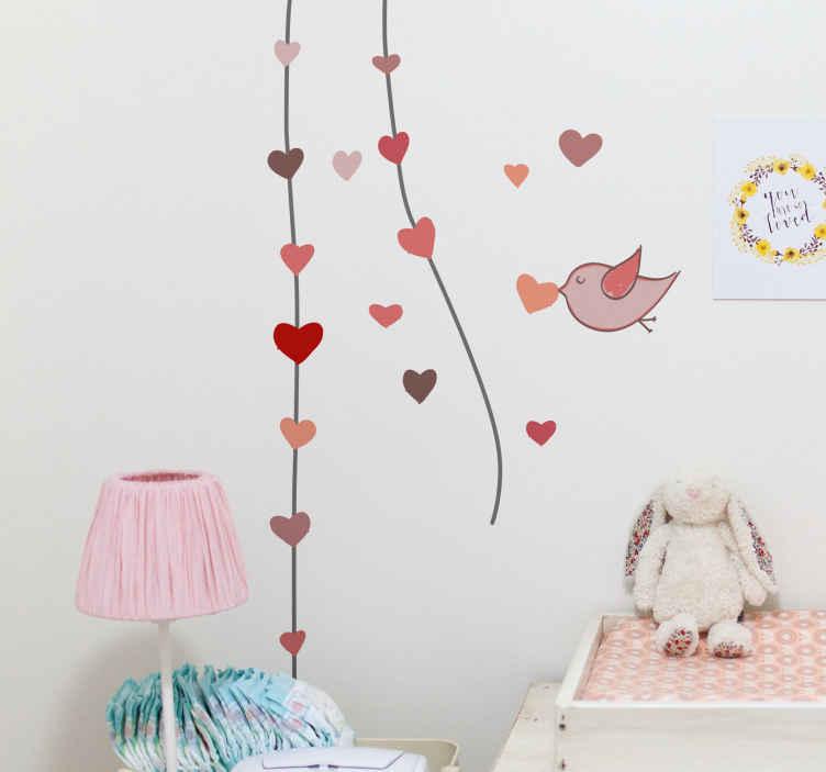 TenVinilo. Vinilo decorativo ave corazón en boca. Bonito diseño adhesivo de un pájaro que carga el símbolo del amor y vuela hacia unas lianas.