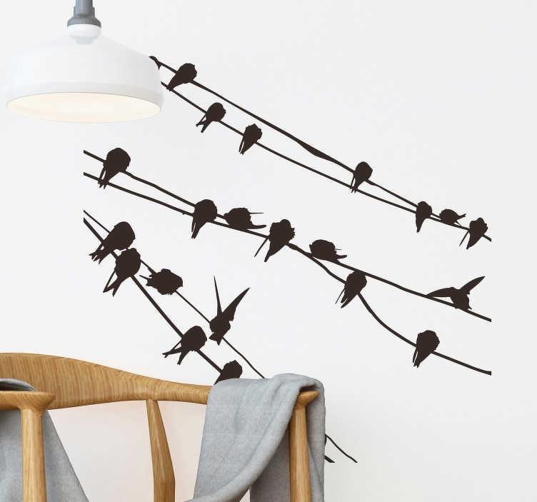 TenVinilo. Vinilo decorativo pájaros cable teléfono. Adhesivo de con la silueta de decenas de aves descansando entre ramas y cableado telefónico.