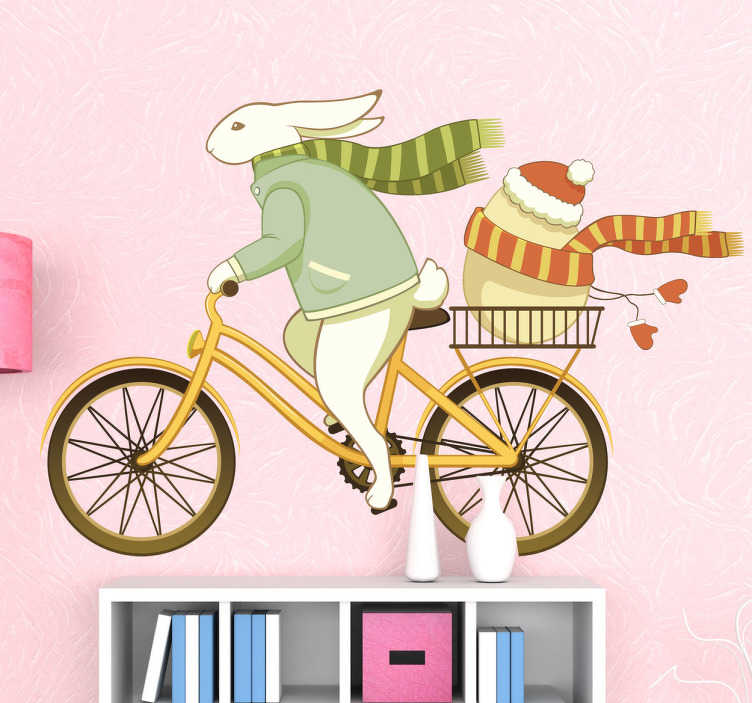 TenStickers. Muursticker haas ei fietsen. Deze muursticker omtrent een paashaas die al fietsend een groot ei vervoert. Ideaal voor kinderen rond de paasdagen.
