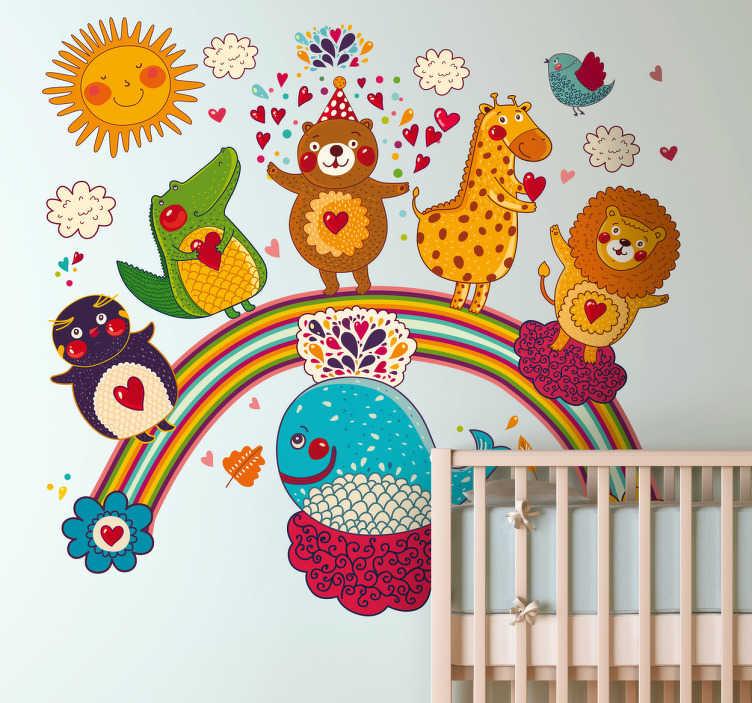 TenVinilo. Vinilo infantil fiesta de los animales. Espectacular adhesivo de un pingüino, un cocodrilo, un león, un oso, una jirafa y una ballena subidos a un arco iris.