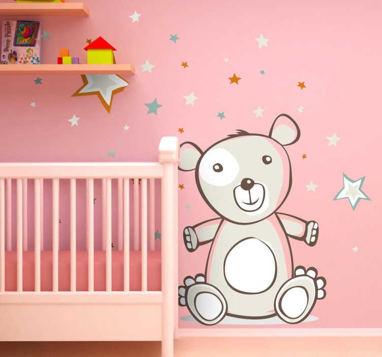 TenVinilo. Vinilo infantil oso peluche y estrellas. Ilustración adhesiva de un cariñoso osito con ganas de abrazarte sobre un fondo de estrellas.