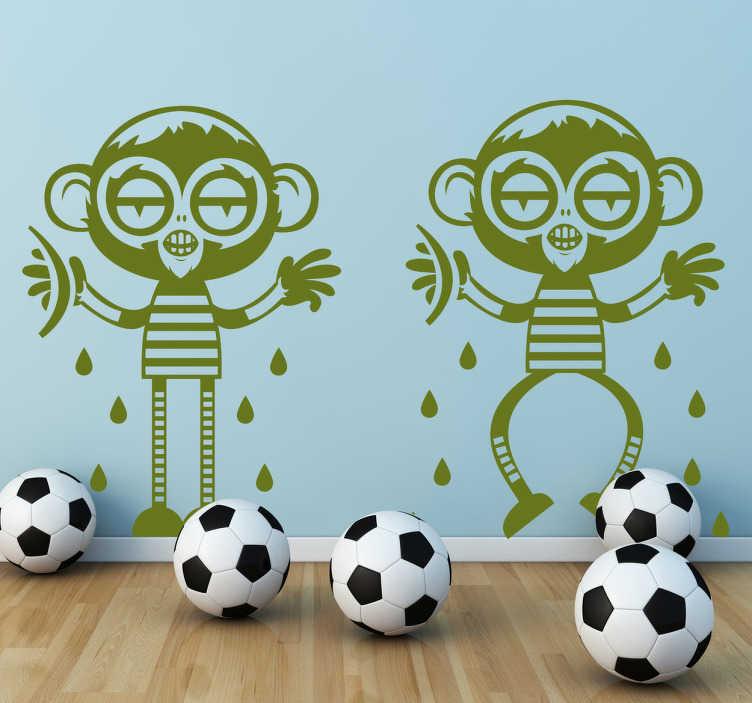 TenStickers. Naklejka dekoracyjna dwie małpy. Naklejka dekoracyjna dla dzieci, która przedstawia szkic dwóch małp, trzymających w rękach jednego banana.