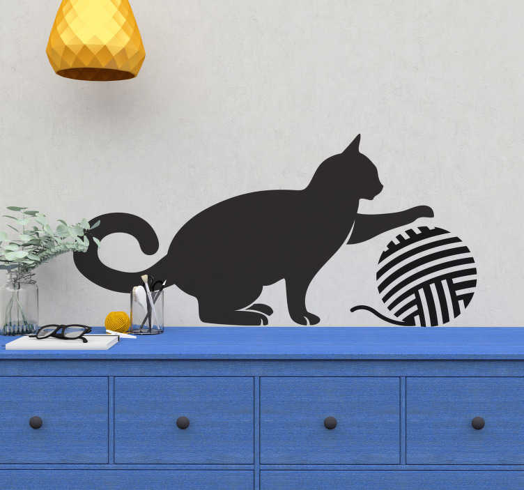 TenStickers. Ball of Wool Cat Wall Sticker. Kids Wall Stickers - Silhouette of a cat play with a ball of wool. Playful design suitable for all ages. Available in 50 colours and in various sizes.