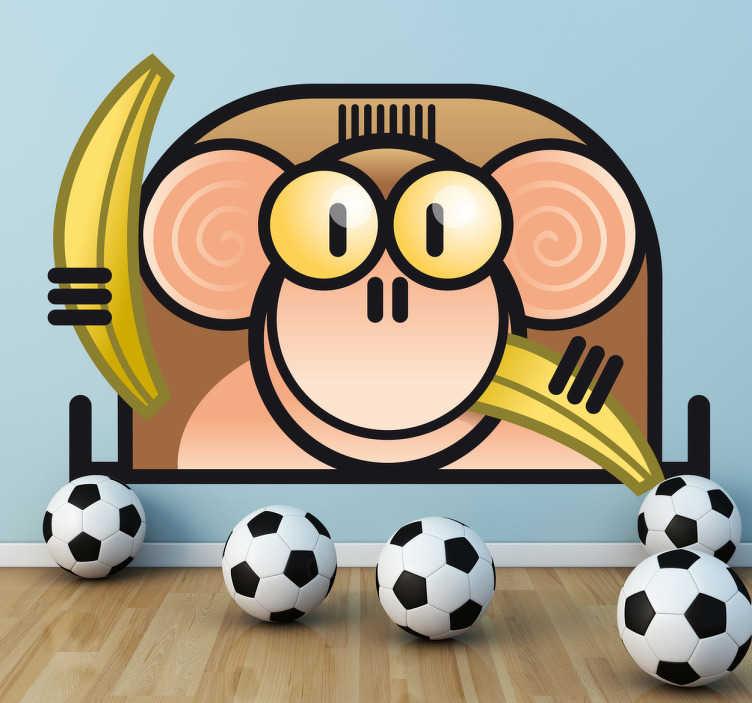 TenStickers. Naklejka dziecięca małpa banany. Naklejka dekoracyjna przedstawiająca rysunek małpki jedzącej z zadowoleniem banany.