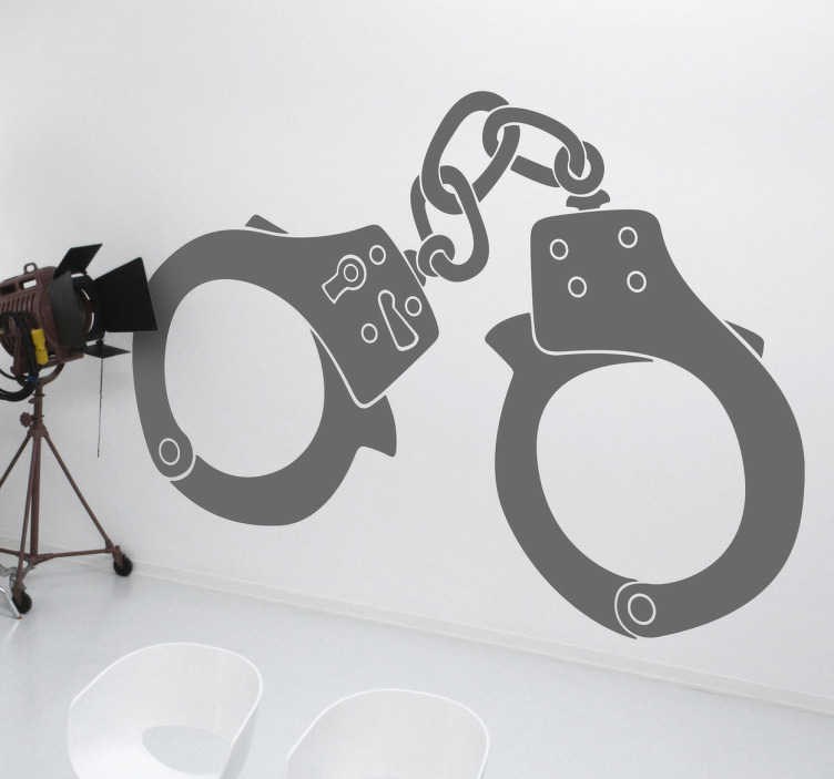 TenStickers. Handcuffs Sticker. A silhouette sticker of some handcuffs that are sure to make your wall more eye-catching.