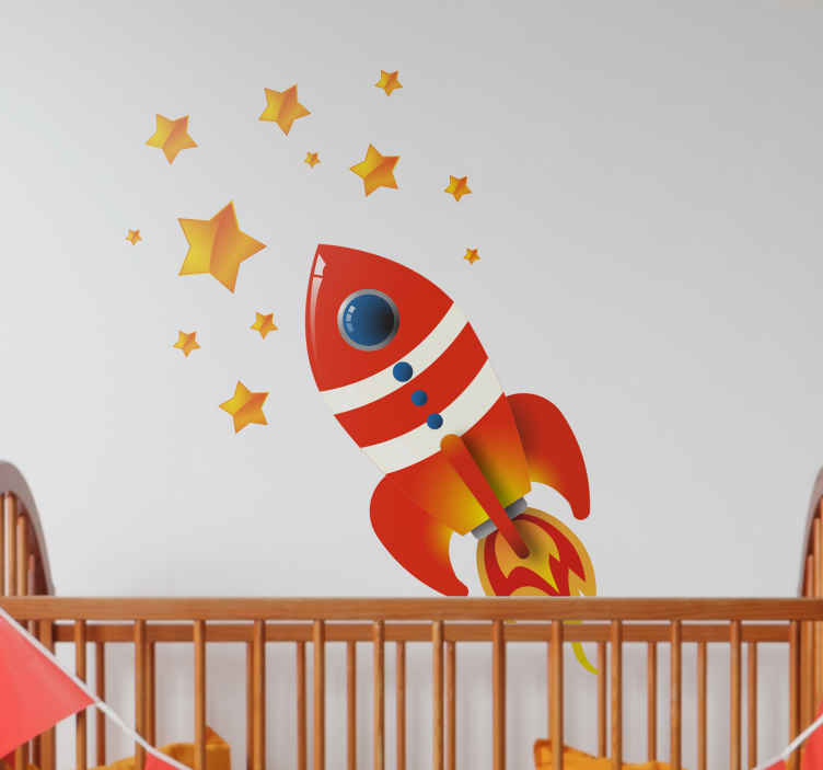 TenStickers. Naklejka dekoracyjna rakieta kosmiczna. Kolorowa naklejka na ściane z rakietą kosmiczną pośrodku gwiazd. Stwórz niepowtarzalny klimat w pokoju Twojej pociechy.