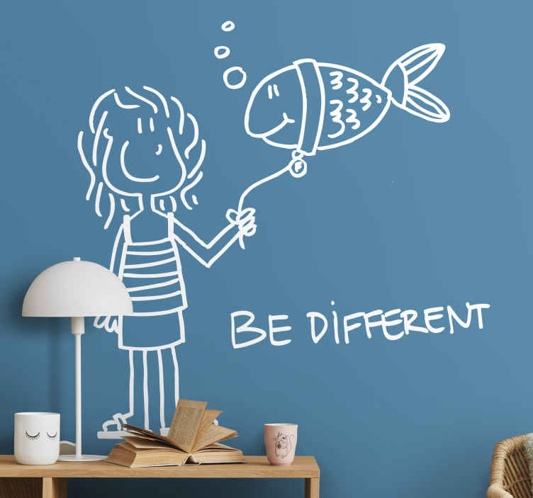 "TenStickers. Fish be different illustration wall art. Decorate your kids room with this wonderful illustration wall sticker with a hand drawing design of a girl and a fish with the quote ""Be different""."