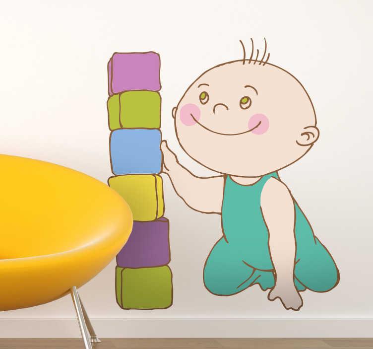 TenStickers. Naklejka dla dzieci klocki. Naklejka na ścianę z uśmiechniętym maluchem układającym kolorowe klocki.
