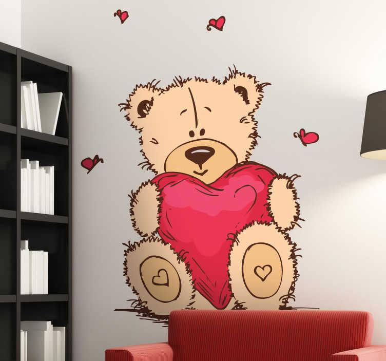 TenVinilo. Vinilo infantil peluche con amor. Pegatinas infantiles de un lindo oso de trapo sujetando un enorme corazón.