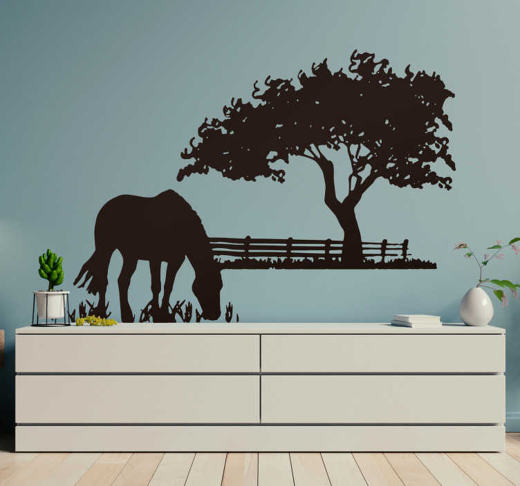 TenStickers. Grazing Horse Wall Sticker. A silhouette illustration of a horse in a meadow. Striking distinctive horse wall art decal for your home or business.
