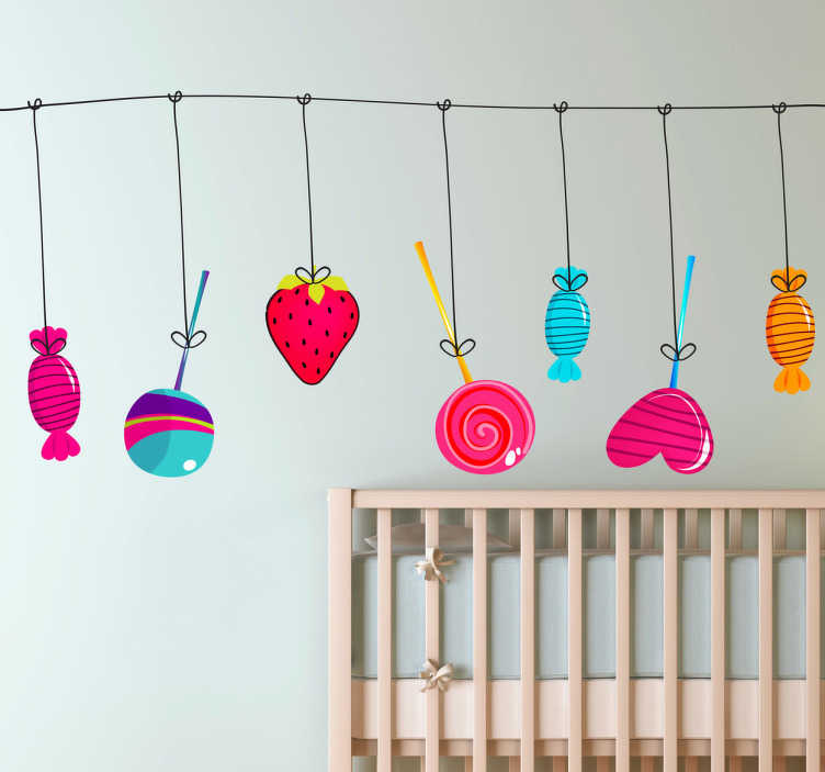 TenStickers. Kids Hanging Treats Decal. A great children's wall sticker illustrating various sweets and treats hanging from a line. Lollipops, strawberries and more!