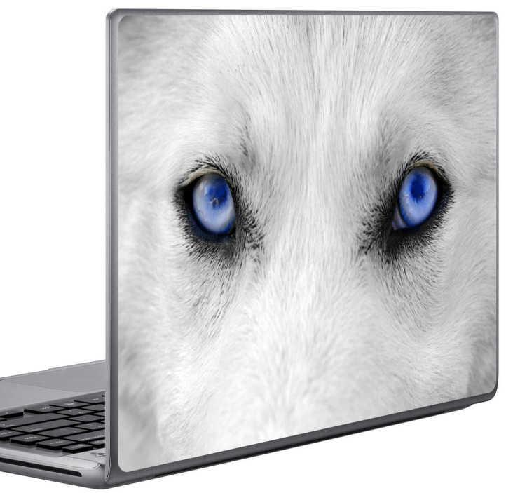 TenStickers. Autocollant pc portable regard du loup. Photo adhésive illustrant un loup aux yeux bleus intenses pour redécorer son ordinateur portable. Selon le format de votre dispositif les dimensions et proportions du stickers peuvent varier légèrement.