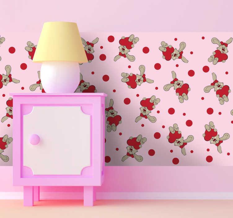 TenStickers. Naklejka na ścianę króliczek z sercem. Naklejka na ścianę dla dzieci przedstawiająca motyw króliczków z serduszkami na różowym tle. Idealna dekoracja dla dzieci, która odmieni każde dziecięce królestwo.