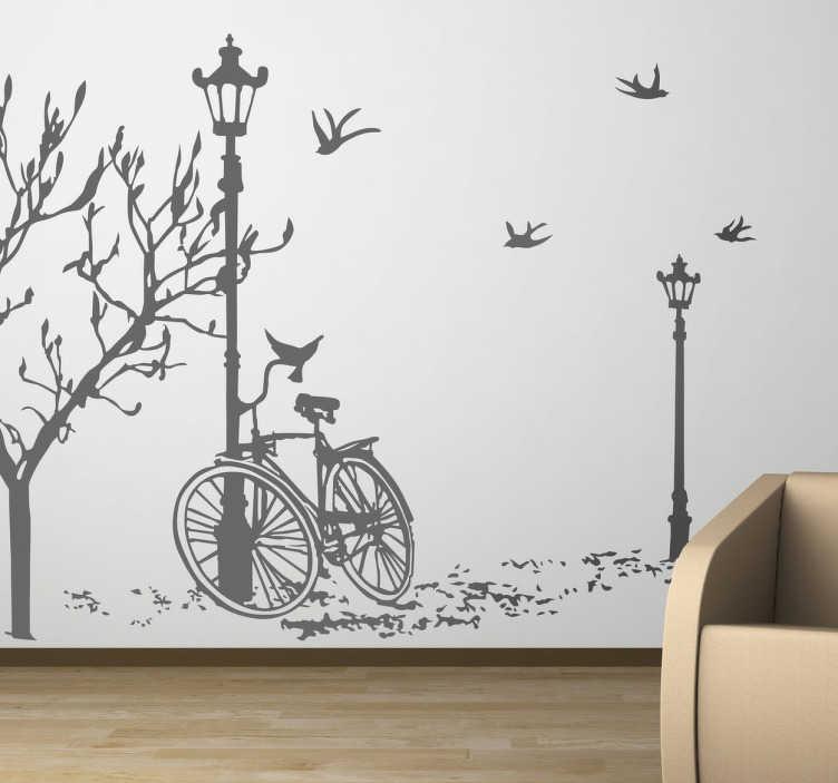 TenVinilo. Vinilo decorativo silueta bici farola. Melancólico adhesivo en la que se muestra una bicicleta en un paseo de un parque urbano en época otoñal.