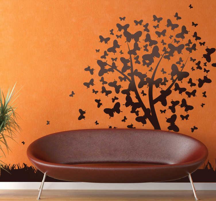 TenVinilo. Vinilo decorativo árbol de mariposas. Espectacular silueta en adhesivo de un prado en la que cientos de insectos alados dibujan completan la copa de un arbusto.