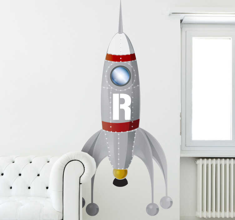 TenStickers. Naklejka dla dzieci rakieta. Naklejka na ścianę z rakietą kosmiczną dzięki której Twoje dziecko będzie latać wyobraźnią do przestrzeni pozaziemskiej.