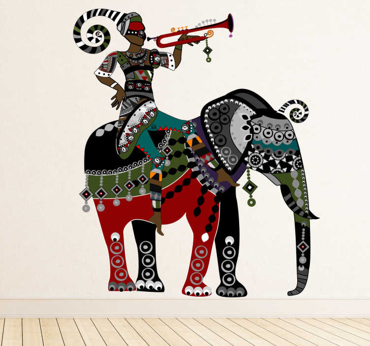 TenStickers. Naklejka dekoracyjna jeździec słoń trąbka. Ciekawa naklejka dekoracyjna w etnicznym stylu. Obrazek przedstawia jeźdźca grającego na trąbce i siedzącego na słoniu.
