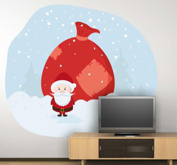 TenStickers. Naklejka wór prezentów. Naklejka świąteczna przedstawiająca śnieżny krajobraz a na jego tle małą postać Mikołaja, a za nim parokrotnie większy  wór prezentów.