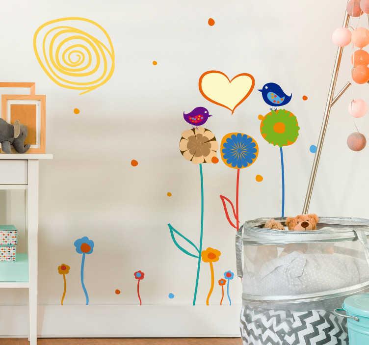 TenStickers. Idyllischer Garten Aufkleber. Das Wandtattoo illustriert eine kleine Blumewiese mit drei großen Blumen, auf denen zwei Vögel sitzen.