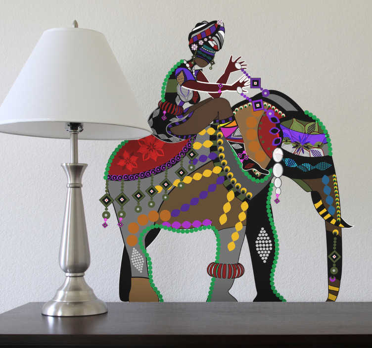 TenStickers. sticker olifant met ruiter India. Een leuke muursticker van een prachtig versierde olifant met hierop een ruiter. Bepaal zelf de gewenste grootte voor deze wanddecoratie.