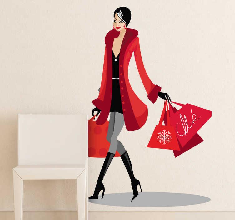TenVinilo. Vinilo decorativo mujer compradora. Una joven con mucho glamour pasea por el boulevard cargada de bolsas. Un adhesivo para incentivar el consumismo.