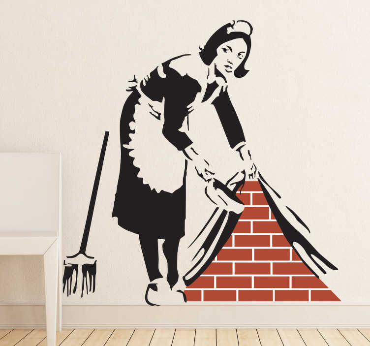 TenStickers. Maid in London by Banksy Art Sticker. A street art wall sticker of the art piece made by the mysterious artist, Banksy. A lovely design from our collection of Banksy wall stickers! Design shows a monochrome maid sweeping dirt under behind the wall to reveal bricks, symbolising what? You decide.