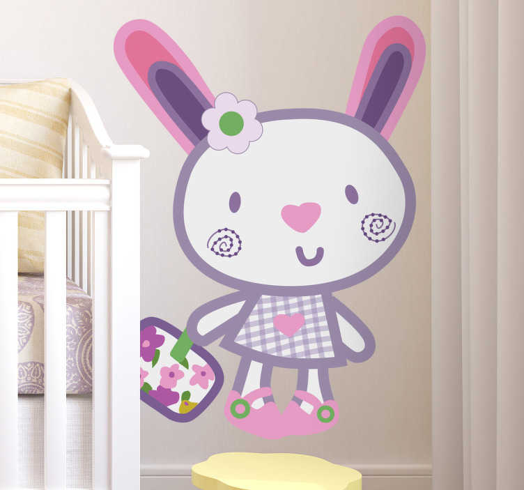 TenStickers. Sticker kinderkamer konijn roze. Een leuke muursticker met de afbeelding van een paars konijntje met een bloemetje in haar haren en een hartje als neus.