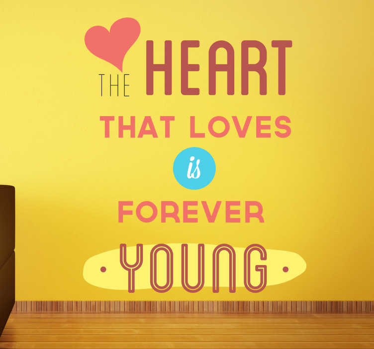 """TenStickers. Sticker decorativo testo heart. """"Il cuore che ama, é sempre giovane"""". Un colorito adesivo murale che porta con se un grande messaggio. Il testo é il lingua inglese"""