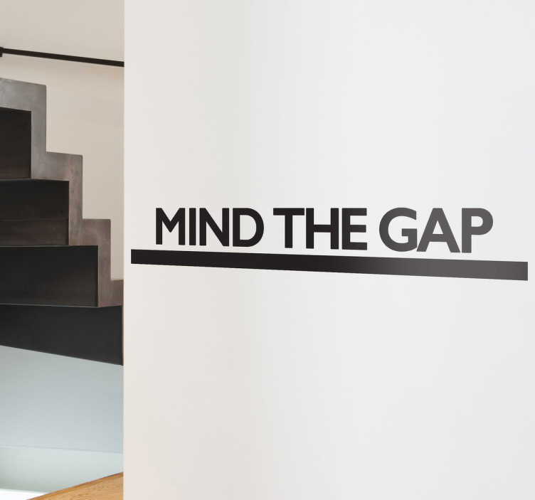 """TenStickers. Mind The Gap Wall Sticker. A text wall decal that will make everyone aware of being careful when going up the stairs. A monochrome wall sticker that can be placed at work and also at home. This """"Mind The Gap"""" decal is available in different sizes and colours."""