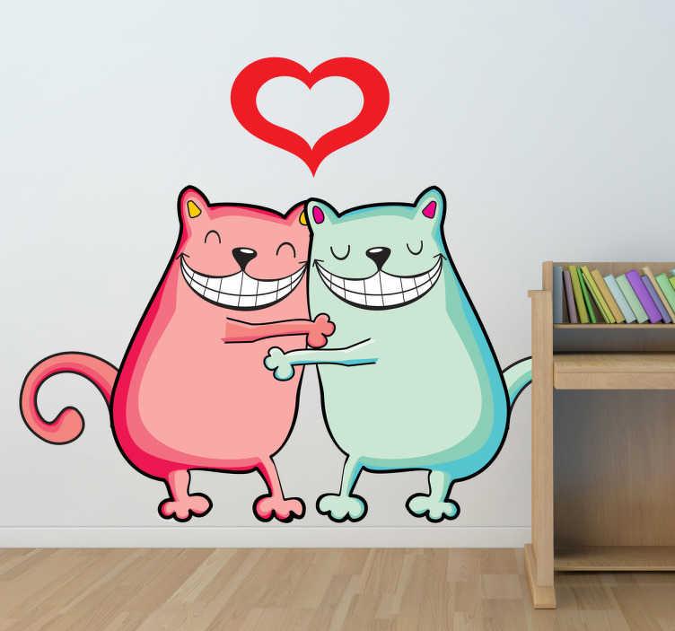 TenStickers. Muursticker katjes liefde. Deze sticker omtrent twee katten die elkaar knuffelen met vrolijke vormen en felle kleuren. Ideaal voor kinderen.
