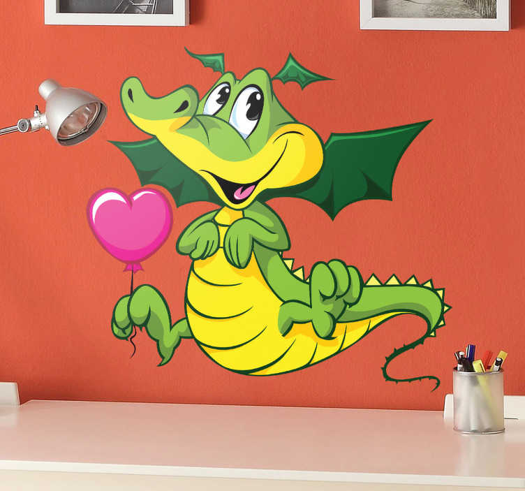 TenStickers. Kids Loving Baby Dragon Wall Sticker. Kids Wall Stickers - Adorable and cute comic illustration of a smiling baby dragon holding a heart balloon.
