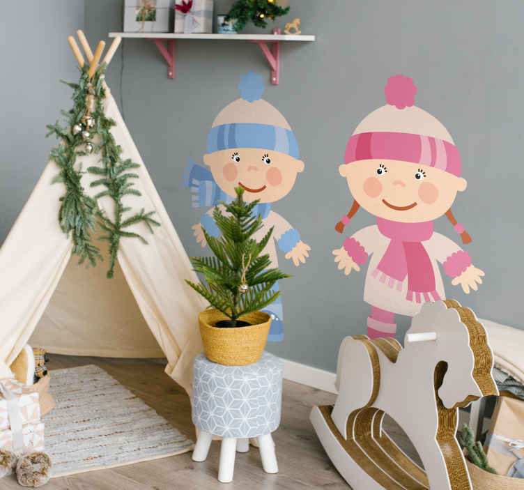TenStickers. Kids Stickers Winter Toddlers. Kids wall sticker art - illustration of toodler boy and girl dressed for the winter.Decals ideal for decorating play areas and nurseries for kids.