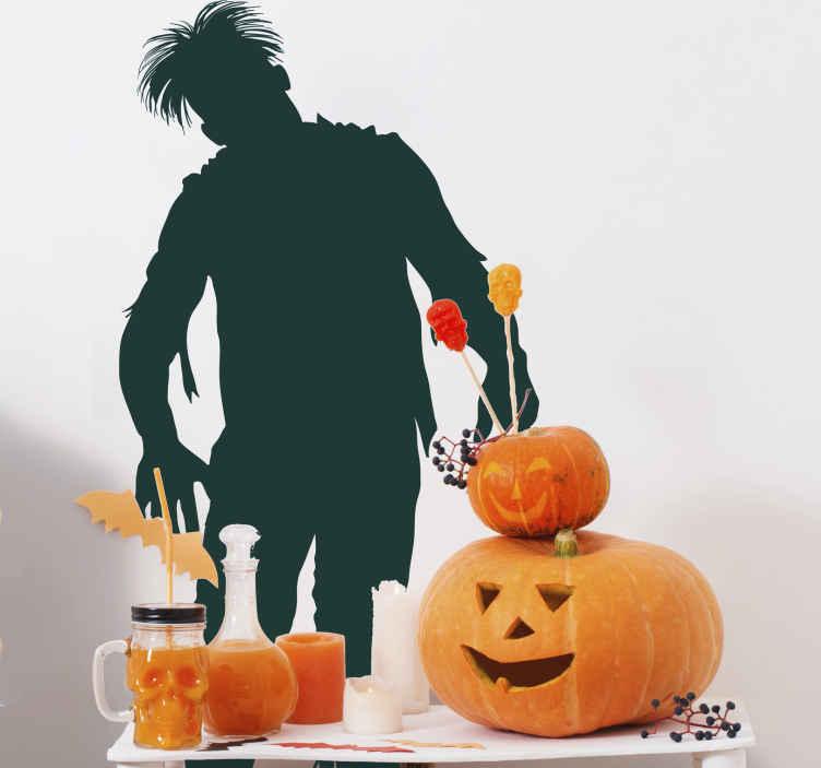 TenStickers. Sticker decorativo silhouette zombi. Wall sticker che raffigura la silhouette di un morto vivente pronto ad attaccare le sue prossime vittime. Una decorazione ideale per gli amanti del genere horror.