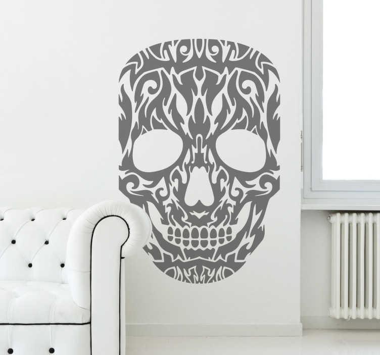 TenVinilo. Vinilo decorativo calavera tribal. Adhesivo monocolor con el rostro de un esqueleto con el que le darás un toque temible a tu hogar.