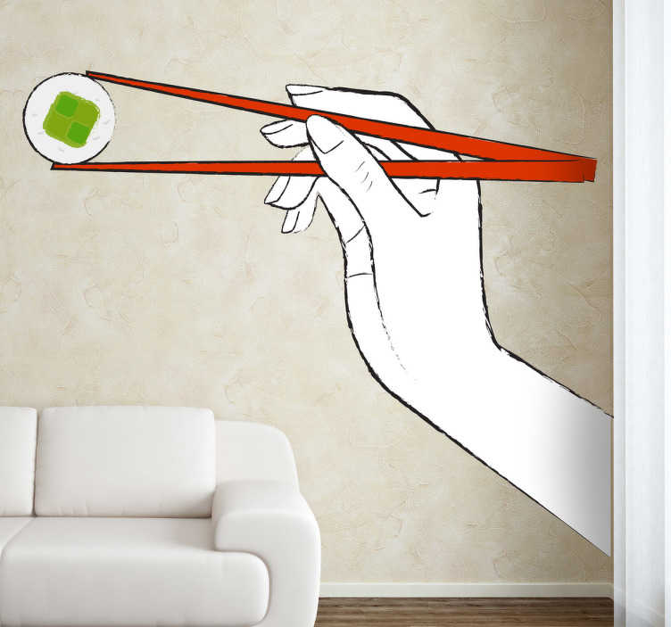 TenStickers. Sticker sushi baguettes. Personnalisez votre décoration avec cette illustration simple et élégante d'un sushi tenu entre deux baguettes par une main.