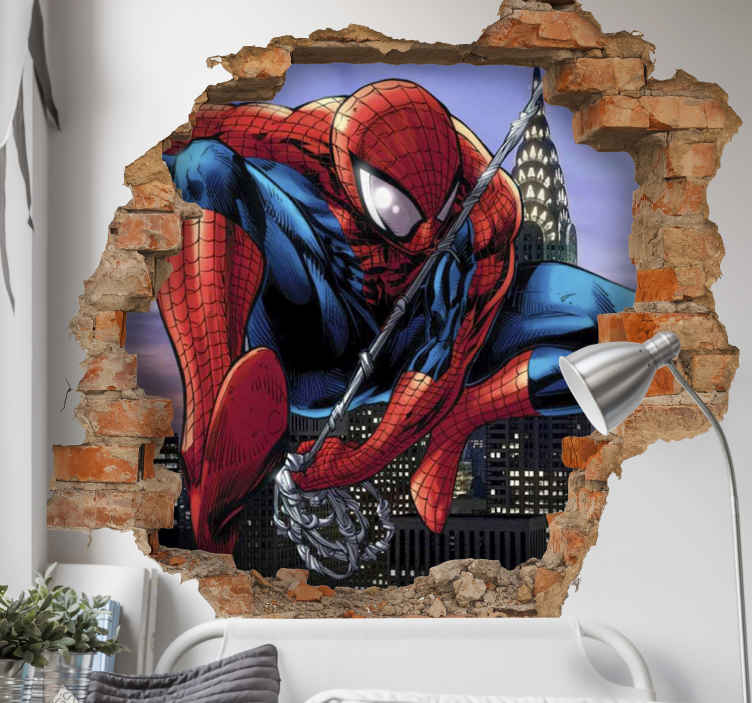 TenStickers. Spiderman through the wall visual effects wall sticker. Decorative 3D superhero wall sticker of Spiderman breaking through a brick wall space. Behind the broken brick wall is an amazing view of a city.