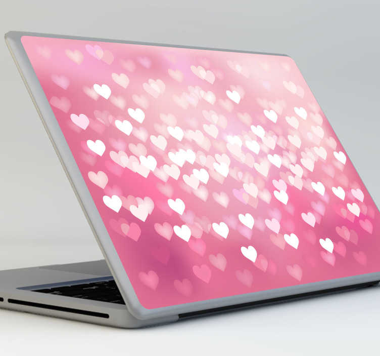 TenStickers. Skin adesiva portatile texture cuoricini. Personalizza il tuo pc portatile con questo simpatico adesivo che raffigura centinaia di cuori bianchi su sfondo rosa.