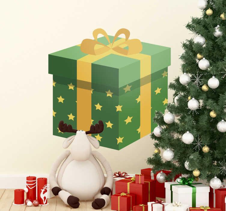 TenStickers. Naklejka zielony prezent. Naklejka świąteczna przedstawiająca duży zielony prezent obwiązany fioletową wstążką. Umieść naklejkę w domu bądź na witrynie sklepowej.