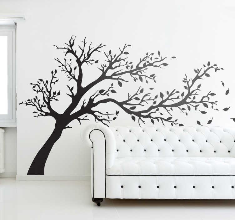 TenStickers. Vinil decorativo árvore outonal ao vento. Vinil decorativo com a silhueta de uma árvore outonal a ser levada pelo vento assoprada pelo vento.