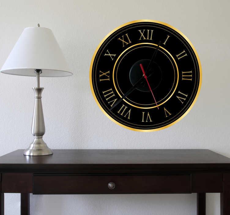 TenStickers. Sticker horloge dorée. Luxe et élégance sur vos murs avec ce sticker horloge effet or.  Comprend horloge 23 cm de diamètre et mécanisme 8,5 cm de diamètre.  Aiguille heures : 9,3 cm / Aiguille minutes : 13,2 cm / Aiguille secondes : 9 cm