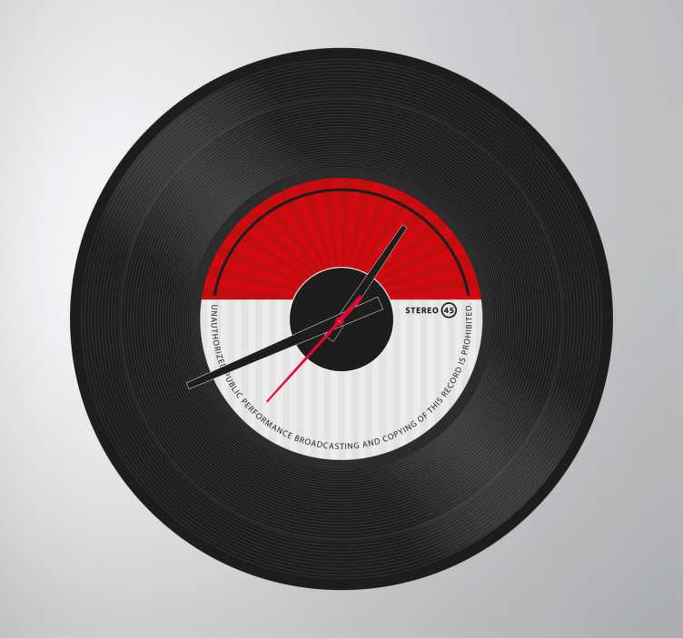 TenStickers. Naklejka zegar płyta gramofonowa. Naklejka dekoracyjna z wbudowanym zegarem. Obrazek przedstawia klasyczną płytę gramofonową.  Naklejka zawiera mechanizm zegara o średnicy Ø23 cm, średnica mechanizmu zegara Ø8,5cm  Długość wskazówki godzinowej: 9,3cm Długość wskazówki minutowej: 13,2cm Długość wskazówki sekundowej: 9cm