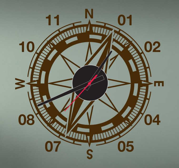 TenStickers. Sticker horloge boussole. Sticker horloge façon boussole pour les plus aventuriers.  Comprend horloge 23 cm de diamètre et mécanisme 8,5 cm de diamètre.  Aiguille heures : 9,3 cm / Aiguille minutes : 13,2 cm / Aiguille secondes : 9 cm