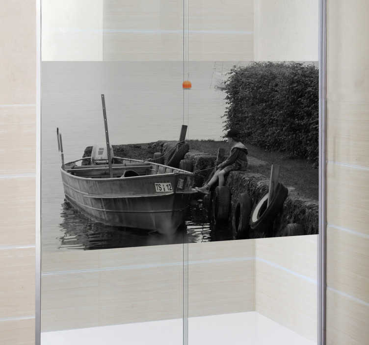 TenStickers. Boy Boat Shower Decal. Shower Decal - A black and white still shot of a young boy sitting along side a docked wooden boat. A distinctive feature great for the bathroom