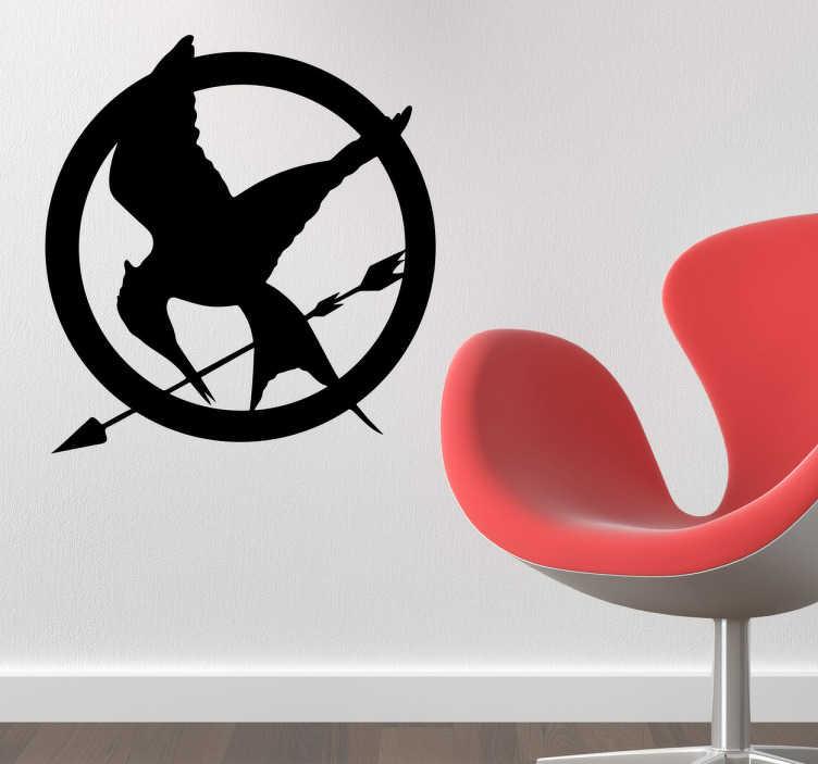 """TenStickers. Naklejka logo z """"Igrzysk Śmierci"""". Naklejka dekoracyjna przedstawiająca ptaka trzymającego strzałę z filmu """"Igrzysk Śmierci"""", który wyskał rzeszę fanów na całym świecie."""