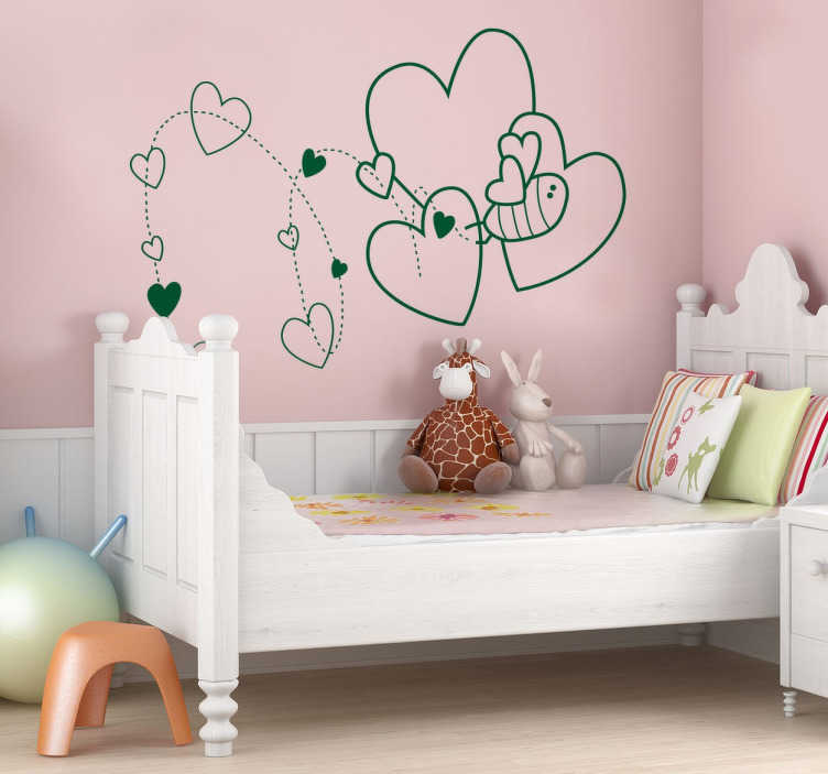 TenVinilo. Vinilo decorativo infantil abeja. Vinilo decorativo infantil ideal para decorar la habitación de tus hijos con el vuelo de la abeja que deja corazones a su paso. Haz volar la imaginación de los más pequeños y decora tu hogar de forma creativa y única.